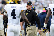 Jim Harbaugh head coach of the Michigan Wolverines reacts after De'Veon Smith #4 scores a touchdown in the fourth quarter against the Penn State Nittany Lions at Beaver Stadium on November 21, 2015 in State College, Pennsylvania.