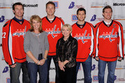 "(Back row, L-R) Washington Capitols players Mike Knuble, David Steckel, Brian Pothier and Chris Clark pose with Teresa Carlson, Vice President, US Federal Government Microsoft Corporation (front row, left) and Elaine B. Rogers, President USO Metropolitan Washington (front row, right) during Microsoft's ""A Salute to Our Troops"" Operation USO Care Package Day at Kettler Iceplex on November 9, 2009 in Arlington, Virginia."