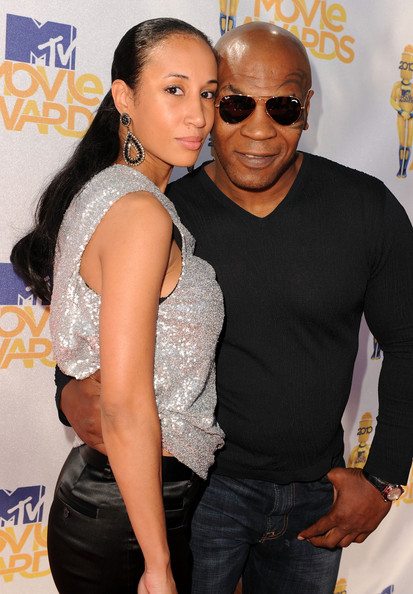 Mike Tyson (R) and wife Lakiha Spicer arrive at the 2010 MTV Movie Awards