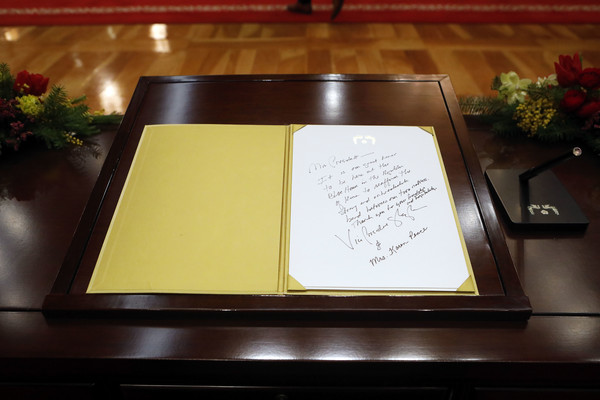 U.S. Vice President Mike Pence Visits South Korea [text,yellow,table,calligraphy,mike pence,moon jae-in,message,guestbook,south korea,u.s.,cheong wa dae,blue house,seoul,meeting]
