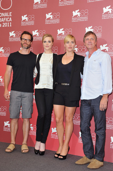 "(L-R) Actor Guy Pearce with actresses  Evan Rachel Wood and Kate Winslet and director Todd Haynes poses at the ""Mildred Pierce"" photocall at the Palazzo del Cinema during the 68th Venice Film Festival on September 2, 2011 in Venice, Italy."