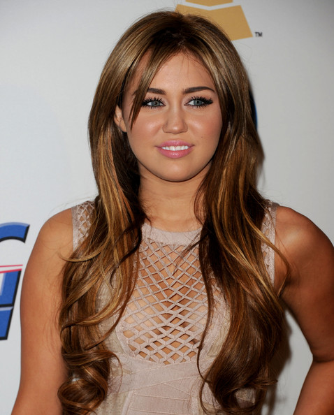 Miley Cyrus Singer Miley Cyrus arrives at the 2011 Pre-GRAMMY Gala and Salute To Industry Icons Honoring David Geffen at Beverly Hilton on February 12, 2011 in Beverly Hills, California.