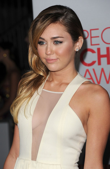 Miley Cyrus Singer Miley Cyrus arrives at the 2012 People's Choice Awards held at Nokia Theatre L.A. Live on January 11, 2012 in Los Angeles, California.