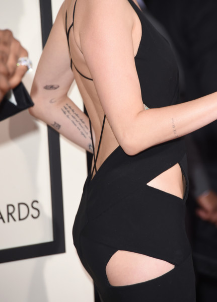 57th GRAMMY Awards - Arrivals [tattoo,clothing,shoulder,fashion,dress,joint,arm,leg,thigh,human body,flooring,arrivals,miley cyrus,grammy awards,detail,dress,california,los angeles,staples center,the 57th annual grammy awards]