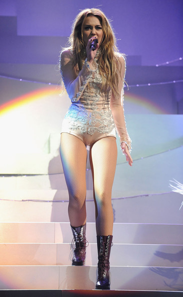 Miley Cyrus Miley Cyrus performs onstage during the MTV Europe Music Awards 2010 live show at La Caja Magica on November 7, 2010 in Madrid, Spain.