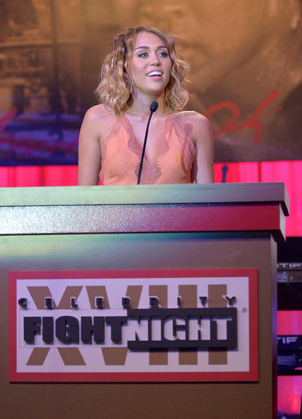 Miley Cyrus Actress/singer Miley Cyrus speaks onstage during Muhammad Ali's Celebrity Fight Night XIII held at JW Marriott Desert Ridge Resort & Spa on March 24, 2012 in Phoenix, Arizona.
