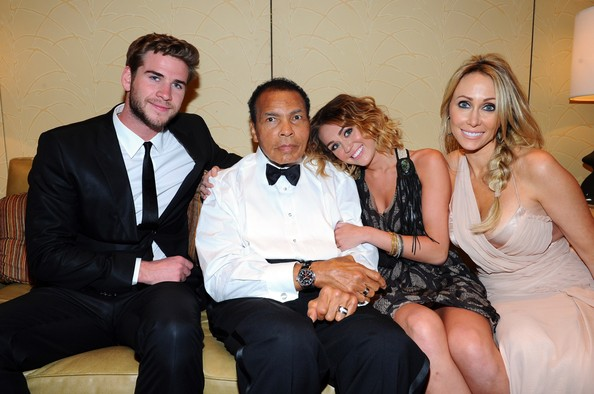 Miley Cyrus Actor Liam Hemsworth, Muhammad Ali, and singer Miley Cyrus with Tish Cyrus pose backstage during Muhammad Ali's Celebrity Fight Night XIII held at JW Marriott Desert Ridge Resort & Spa on March 24, 2012 in Phoenix, Arizona.
