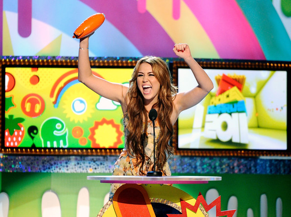 Miley Cyrus Actress/singer Miley Cyrus speaks onstage during Nickelodeon's 24th Annual Kids' Choice Awards at Galen Center on April 2, 2011 in Los Angeles, California.