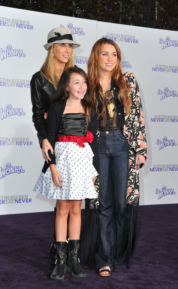 """Miley Cyrus (L-R) Producer Tish Cyrus, and daughters Noah Cyrus and actress/singer Miley Cyrus arrive at the premiere of Paramount Pictures' """"Justin Bieber: Never Say Never"""" held at Nokia Theater L.A. Live on February 8, 2011 in Los Angeles, California."""