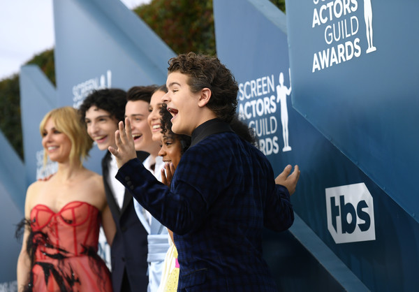 26th Annual Screen Actors Guild Awards - Red Carpet [red carpet,yellow,youth,premiere,event,interaction,photography,flooring,fictional character,gesture,carpet,cara buono,priah ferguson,millie bobby brown,noah schnapp,finn wolfhard,gaten matarazzo,screen actors guild awards,l-r,screen actors\u00e2 guild awards,cara buono,gaten matarazzo,23rd screen actors guild awards,stranger things,millie bobby brown,caleb mclaughlin,actor,red carpet,stranger things - season 3]