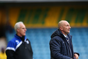 Manager of Millwall FC Ian Holloway (R) and manager of Ipswich Town Mick McCarthy (L) look on during the Sky Bet Championship match between Millwall and Ipswich Town at The Den on January 18, 2014 in London, England,