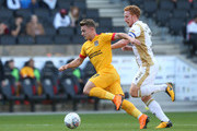 Sam Hoskins of Northampton Town moves forward with the ball away from Dean Lewington of Milton Keynes Dons during the Sky Bet League Two match between Milton Keynes Dons and Northampton Town at Stadium mk on October 20, 2018 in Milton Keynes, United Kingdom.