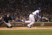 Anthony Rizzo #44 of the Chicago Cubs hits an RBI fielders choice against the Milwaukee Brewers during the first inning on September 10, 2018 at Wrigley Field  in Chicago, Illinois.