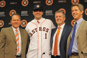 (L-R) Agent Scott Boras, Mark Appel, general managerJeff Luhnow and director of amateur scouting Mike Elias pose for the media after the Houston Astros signed first overall draft pick Appel to the team prior to the start of the game between the Milwaukee Brewers and the Houston Astros at Minute Maid Park on June 19, 2013 in Houston, Texas.