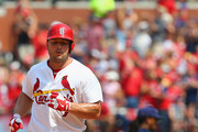 Matt Holliday #7 of the St. Louis Cardinals rounds the bases after hitting a solo home run against the Milwaukee Brewers in the seventh inning at Busch Stadium on August 3, 2014 in St. Louis, Missouri.  The Cardinals beat the Brewers 3-2.