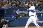 Troy Tulowitzki #2 of the Toronto Blue Jays is brushed back by an inside pitch in the fourth inning during MLB game action against the Milwaukee Brewers at Rogers Centre on April 12, 2017 in Toronto, Canada.
