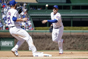 Anthony Rizzo #44 of the Chicago Cubs flips the ball to Tyler Chatwood #21 at first base in the sixth inning of a game against the Milwaukee Brewers at Wrigley Field on April 29, 2018 in Chicago, Illinois. The Cubs won 2-0.