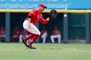 Joey Votto #19 of the Cincinnati Reds fields a ground ball hit by Ryan Braun #8 of the Milwaukee Brewers and forces him out first base during the sixth inning at Great American Ball Park on August 30, 2018 in Cincinnati, Ohio. Milwaukee defeated Cincinnati 2-1 in 11 innings.