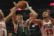 Ersan Ilyasova #7 of the Milwaukee Bucks tries to shoot between Derrick Rose #1 and Joakim Noah #13 of the Chicago Bulls at the United Center on February 22, 2012 in Chicago, Illinois. NOTE TO USER: User expressly acknowledges and agrees that, by downloading and or using this photograph, User is consenting to the terms and conditions of the Getty Images License Agreement.