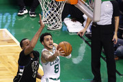 Shane Larkin #8 of the Boston Celtics takes a shot against John Henson #31 of the Milwaukee Bucks in the third quarter of Game Two in Round One of the 2018 NBA Playoffs at TD Garden on April 17, 2018 in Boston, Massachusetts.