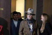 """Johnny Depp (R) and director Andrew Levitas arrive for the """"Minamata"""" photo call during the 70th Berlinale International Film Festival Berlin at Grand Hyatt Hotel on February 21, 2020 in Berlin, Germany."""