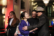 """(R-L) Johnny Depp, Hiroyuki Sanada and Akiko Iwase arrive for the """"Minamata"""" premiere during the 70th Berlinale International Film Festival Berlin at Friedrichstadt-Palast on February 21, 2020 in Berlin, Germany."""