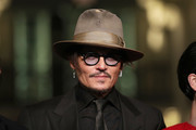 """Johnny Depp arrives for the """"Minamata"""" premiere during the 70th Berlinale International Film Festival Berlin at Friedrichstadt-Palast on February 21, 2020 in Berlin, Germany."""