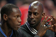 Kevin Garnett #21 of the Minnesota Timberwolves (R) talks with teammate Gorgui Dieng #5 on the bench during a game against the Chicago Bulls at the United Center on February 27, 2015 in Chicago, Illinois. NOTE TO USER: User expressly acknowledges and agrees that, by downloading and or using this photograph, User is consenting to the terms and conditions of the Getty Images License Agreement.