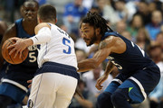 Derrick Rose #25 of the Minnesota Timberwolves  defends J.J. Barea #5 of the Dallas Mavericks at American Airlines Center on October 20, 2018 in Dallas, Texas.  NOTE TO USER: User expressly acknowledges and agrees that, by downloading and or using this photograph, User is consenting to the terms and conditions of the Getty Images License Agreement.