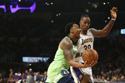Jeff Teague #0 of the Minnesota Timberwolves drives around Dwight Howard #39 of the Los Angeles Lakers during the first half at Staples Center on December 08, 2019 in Los Angeles, California. NOTE TO USER: User expressly acknowledges and agrees that, by downloading and or using this photograph, User is consenting to the terms and conditions of the Getty Images License Agreement.
