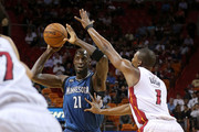 Kevin Garnett #21 of the Minnesota Timberwolves passes over Chris Bosh #1 of the Miami Heat during a game  at American Airlines Arena on November 17, 2015 in Miami, Florida. NOTE TO USER: User expressly acknowledges and agrees that, by downloading and/or using this photograph, user is consenting to the terms and conditions of the Getty Images License Agreement. Mandatory copyright notice: