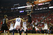 Clint Capela #15 of the Houston Rockets goes up for a lay up defended by Jimmy Butler #23 of the Minnesota Timberwolves and Karl-Anthony Towns #32 in the first half during Game Five of the first round of the 2018 NBA Playoffs at Toyota Center on April 25, 2018 in Houston, Texas.  NOTE TO USER: User expressly acknowledges and agrees that, by downloading and or using this photograph, User is consenting to the terms and conditions of the Getty Images License Agreement.