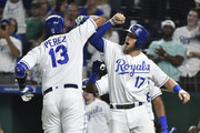 Salvador Perez #13 of the Kansas City Royals celebrates his two-run home run with Hunter Dozier #17 in the sixth inning against the Minnesota Twins at Kauffman Stadium on September 13, 2018 in Kansas City, Missouri.