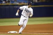 Daniel Nava #7 of the Tampa Bay Rays rounds third base after hitting a home run during the fourth inning of a game against the Minnesota Twins on August 26, 2015 at Tropicana Field in St. Petersburg, Florida.