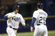 Daniel Nava #7 of the Tampa Bay Rays celebrates with third base coach Charlie Montoyo #25 after hitting a home run during the fourth inning of a game against the Minnesota Twins on August 26, 2015 at Tropicana Field in St. Petersburg, Florida.