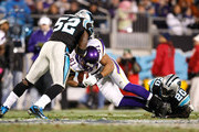 Visanthe Shiancoe #81 of the Minnesota Vikings is tackled by Jon Beason #52 and Chris Gamble #20 of the Carolina Panthers at Bank of America Stadium on December 20, 2009 in Charlotte, North Carolina.