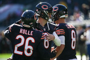 Quarterback Jay Cutler #6 of the Chicago Bears hugs teammate  Antrel Rolle #26 prior to the game against the Minnesota Vikings at Soldier Field on November 1, 2015 in Chicago, Illinois.