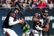 Jeremy Langford #33 of the Chicago Bears fakes having the football as quarterback  Jay Cutler #6 looks to pass against the Minnesota Vikings in the second quarter at Soldier Field on November 1, 2015 in Chicago, Illinois.