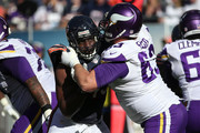Sam Acho #49 of the Chicago Bears is blocked by Brandon Fusco #63 of the Minnesota Vikings in the second quarter at Soldier Field on November 1, 2015 in Chicago, Illinois.