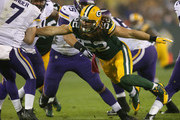Clay Matthews #52 of the Green Bay Packers pressures Christian Ponder #7 of the Minnesota Vikings at Lambeau Field on October 2, 2014 in Green Bay, Wisconsin.