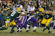 Ha Ha Clinton-Dix #21 of the Green Bay Packers attempts to tackle Adrian Peterson #28 of the Minnesota Vikings during the third quarter of their game at Lambeau Field on January 3, 2016 in Green Bay, Wisconsin.