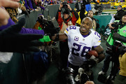 Adrian Peterson #28 of the Minnesota Vikings greets fans after defeating the Green Bay Packers with a score of 20 to 13 at Lambeau Field on January 3, 2016 in Green Bay, Wisconsin.