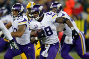 Adrian Peterson #28 of the Minnesota Vikings carries the ball during the fourth quarter against the Green Bay Packers at Lambeau Field on January 3, 2016 in Green Bay, Wisconsin.