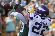 Harrison Smith #22 of the Minnesota Vikings breaks up a pass intended for Jimmy Graham #80 of the Green Bay Packers at Lambeau Field on September 16, 2018 in Green Bay, Wisconsin. The Vikings and the Packers tied 29-29 after overtime.