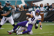 Quarterback Kirk Cousins #8 of the Minnesota Vikings is tackled as he plays against the Philadelphia Eagles during the first quarter at Lincoln Financial Field on October 7, 2018 in Philadelphia, Pennsylvania.  The Vikings won 23-21.