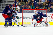 Jason Zucker #16 of the Minnesota Wild gathers up a rebound while being defended by Markus Nutivaara #65 of the Columbus Blue Jackets and Pierre-Luc Dubois #18 of the Columbus Blue Jackets and beats Sergei Bobrovsky #72 of the Columbus Blue Jackets for a goal during the second period on January 30, 2018 at Nationwide Arena in Columbus, Ohio.