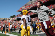 A member of the Minnesota Golden Gophers staff celebrates after Rodney Smith #1 of the Minnesota Golden Gophers ran for a first half touchdown against the Maryland Terrapins at Capital One Field on October 15, 2016 in College Park, Maryland.