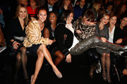 (L-R) Xenia Seeberg, Caroline Beil, Motsi Mabuse, Jorge Gonzalez, Alexandra Kamp, Regina Halmich and Tina Ruland attend the Minx by Eva Lutz show during Mercedes-Benz Fashion Week Autumn/Winter 2014/15 at Brandenburg Gate on January 15, 2014 in Berlin, Germany.