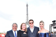 (L-R) Paramount Chairman and CEO Jim Gianopulos, guest, David Ellison and Sandra Lynn Modic attend the Global Premiere of 'Mission: Impossible - Fallout' at Palais de Chaillot on July 12, 2018 in Paris, France.