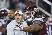 head coach Dan Mullen of the Mississippi State Bulldogs talks with Jeffery Simmons #94 of the Mississippi State Bulldogs during the second half of an NCAA football game at Davis Wade Stadium on November 23, 2017 in Starkville, Mississippi.